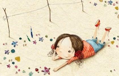 Tyttö leikkii rannalla
