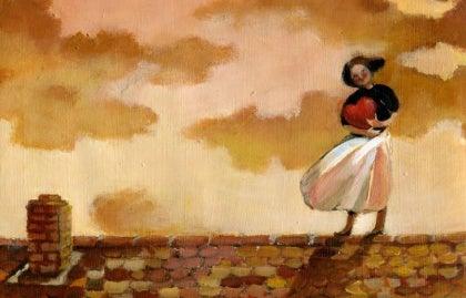 Nainen kantaa sydäntä ja seisoo katolla