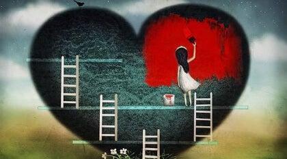 Tyttö maalaa sydäntä punaiseksi