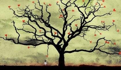 Tyttö poimii sydämen puusta
