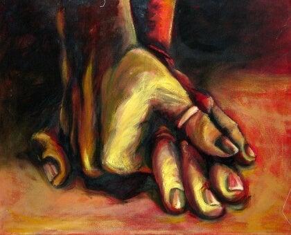 Kädet yhteen kietoutuneina
