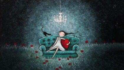 Tyttö ja kissa sohvalla