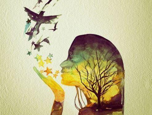 Tyttö puhaltaa lintuja ja tähtiä