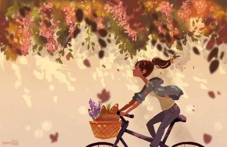 Iloinen tyttö pyöräilee