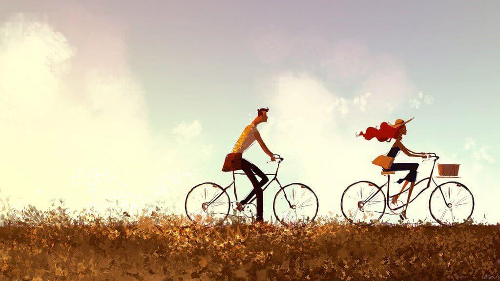 Nainen ja mies nauttivat pyöräilystä