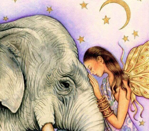 Nainen halaa norsua