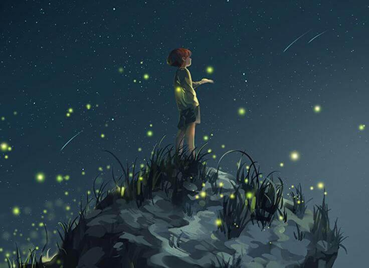 Onnellinen lapsi katsoo tähdenlentoja