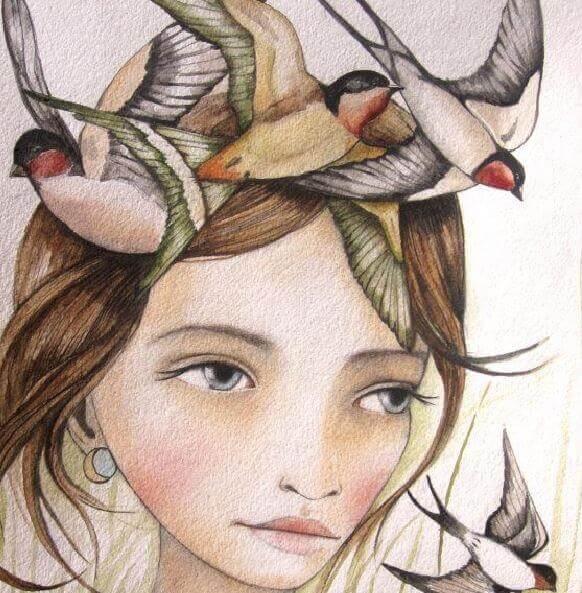 Tytön päässä linnut