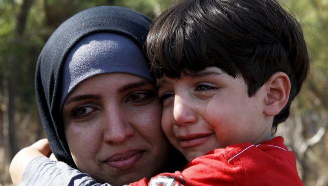 Pakolaiset äiti ja poika