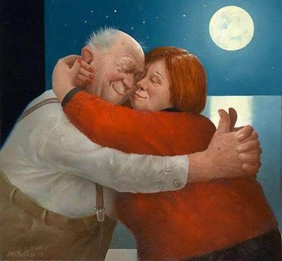Onnellinen pari halaa