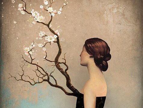 nainen katsoo puuta