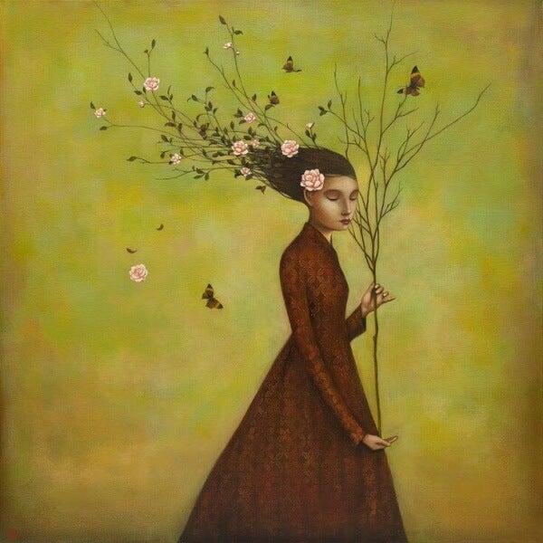 nainen pitelee oksaa