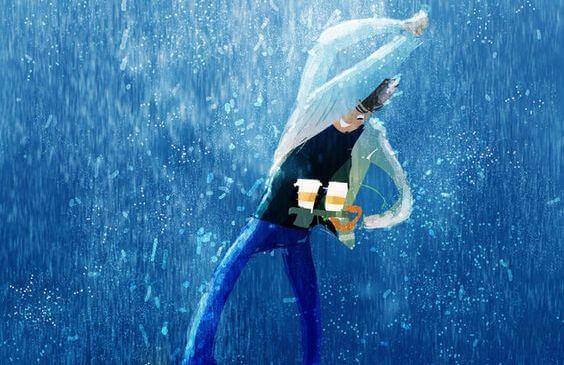 Poika ja kahvikupit sateessa