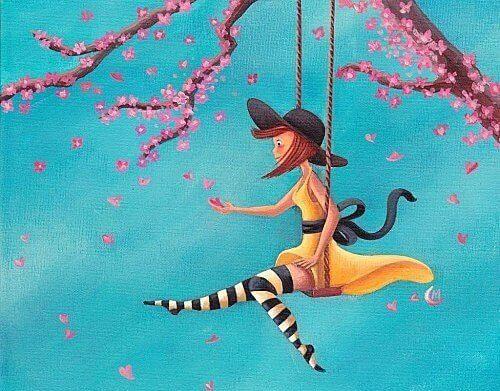 Nainen keinuu puussa