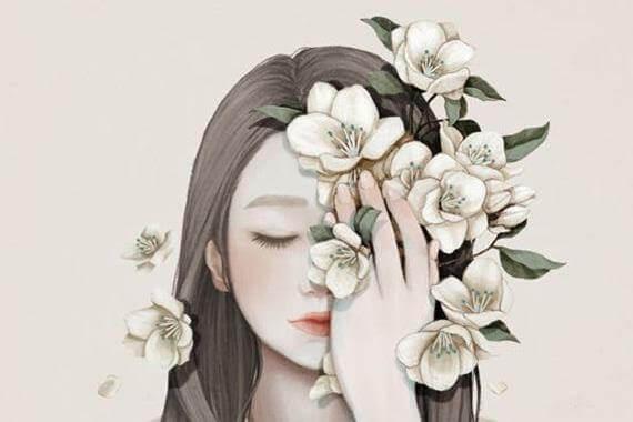nainen kukat kasvoja vasten