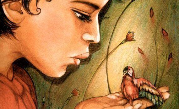 Nainen puhuu linnulle