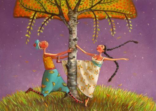 Pariskunta tanssii puun alla