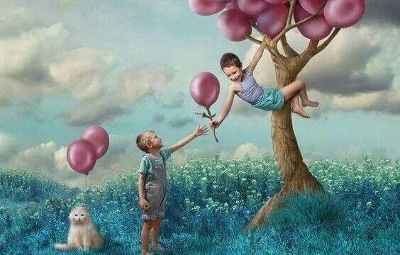 ystävällisyys poika ojentaa ilmapallon toiselle
