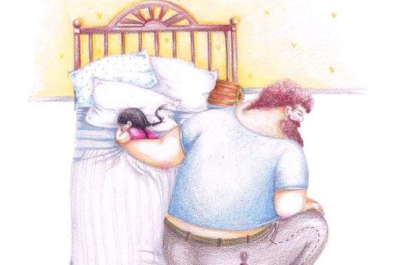 isä laittaa lapsen nukkumaan