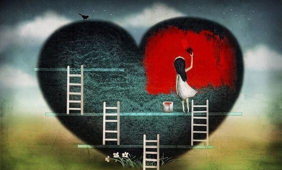 tyttö maalaa sydämen punaiseksi