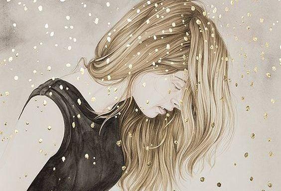 nainen lumisateessa