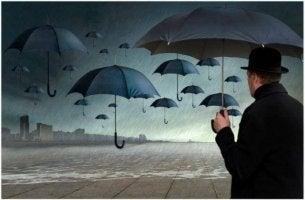 epävarma mies sateenvarjon kanssa