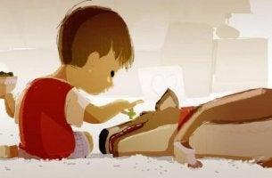 poika ruokkii koiraa