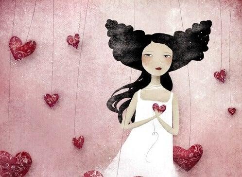 tyttö ja roikkuvat sydämet