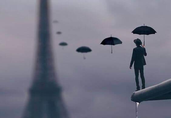 mies ja sateenvarjot