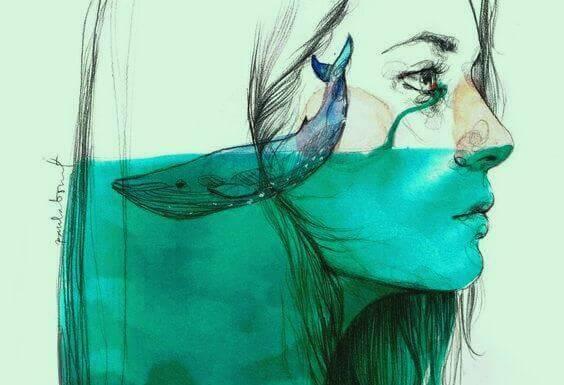 naisen päässä on vettä ja valas