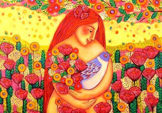 naisella sylissä kukkia ja lintu