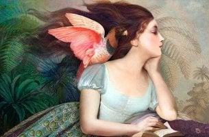 naisen olkapäällä on lintu