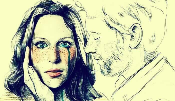 nainen itkee ja mies lohduttaa