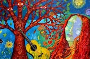 nainen ja kitara puun juurella