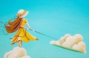 tyttö vetää pilveä