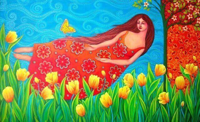 nainen kukkakedolla