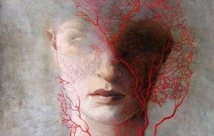 punainen puu naisen kasvojen edessä