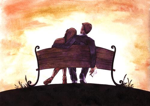 pariskunta istuu penkillä
