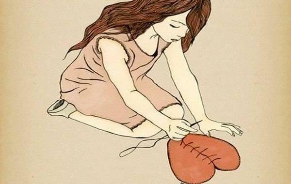 tyttö ompelee sydämen taas yhteen