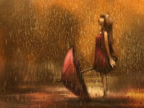 tyttö sateessa sateenvarjo kädessä