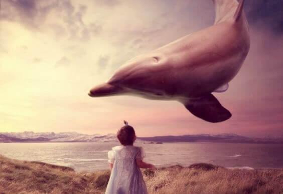 tyttö ja lentävä delfiini