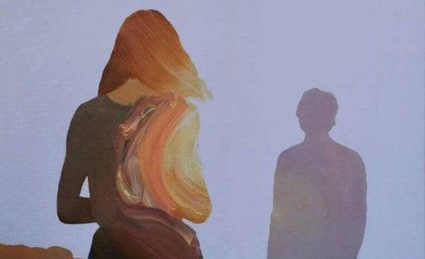 utuinen mies naisen edessä