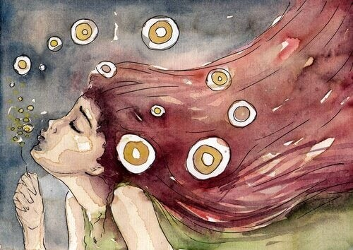 tyttö puhaltaa saippuakuplia