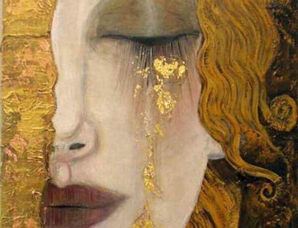 nainen itkee kultaisia kyyneleitä