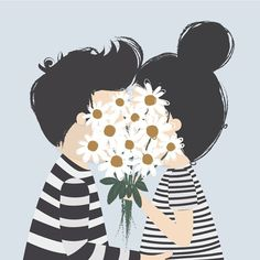 pariskunta suutelee kukkapuskan takana
