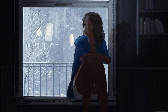 miettivä nainen ikkunalaudalla