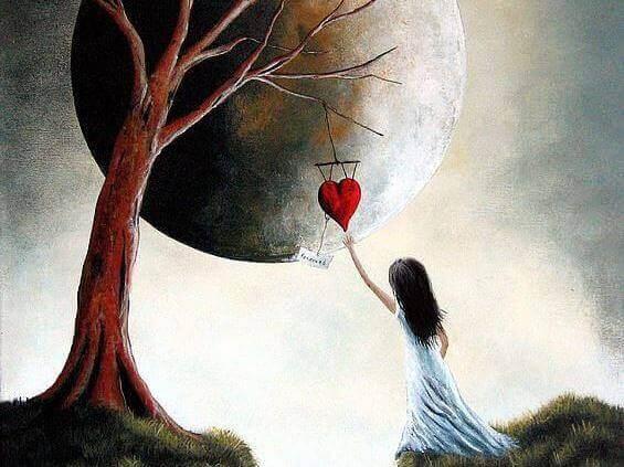 puusta roikkuu sydän jota lapsi tavoittelee