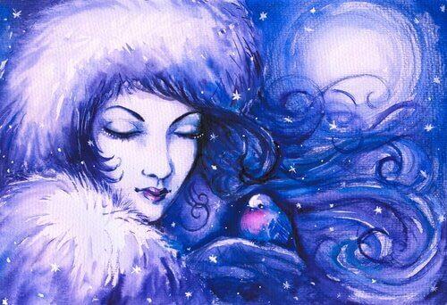 nainen ja lintu talviturkeissaan