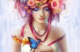 naisella perhonen kädessä