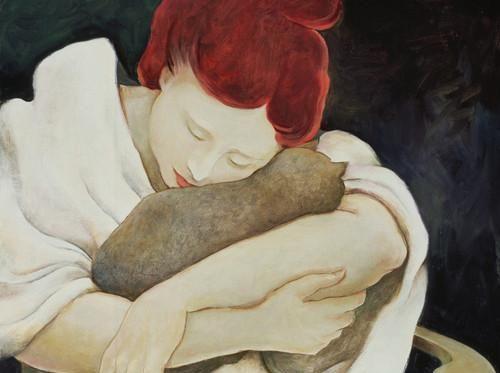 surullinen nainen halaa kissaansa